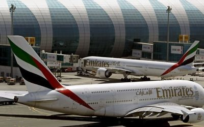 Emirates passenger planes at Dubai airport in United Arab Emirates, on May 8, 2014. (AP Photo/Kamran Jebreili, File)