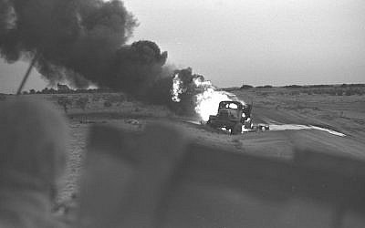 An Egyptian transport burning after a direct hit from an Israeli tank during the Six Day War, June 5, 1967. (David Rubinger/Government Press Office)