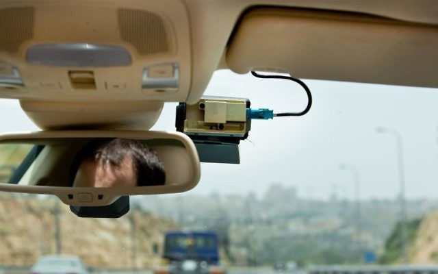 "The ""Mobileye"" mounted on a car windshield, May 27, 2015. (Shai/FLASH90)"