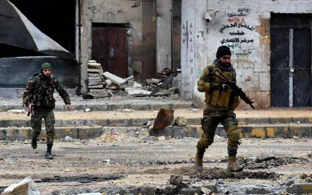 This file photo taken on December 14, 2016 shows Syrian pro-government forces advancing during a military operation in the northern city of Aleppo. (AFP Photo/George Ourfalian)