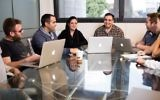 Ron Teicher, CEO of EverCompliant, heads a meeting of company employees. (Courtesy)