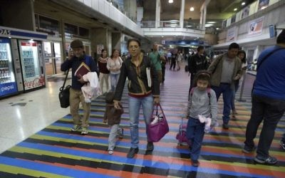 Illustrative: In this March 17, 2017 photo, Jewish converts Sahir Quitero, center, her husband Franklin Perez, son Ezra, left, and daughter Hannah, walk to departures lounge of the Simon Bolivar International Airport in Maiquetia, Venezuela, on their way to Israel. (AP Photo/Fernando Llano)