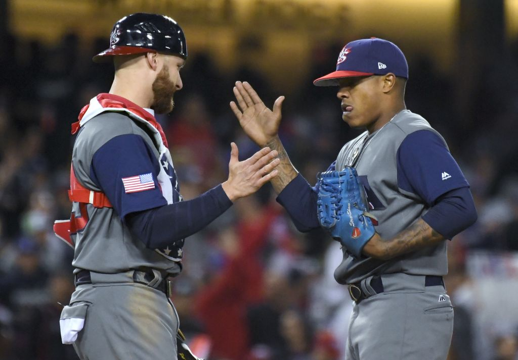 US catcher Jonathan Lucroy, left, greets pitcher Marcus Stroman in the sixth inning against Puerto Rico during the final of the World Baseball Classic. in Los Angeles, Wednesday, March 22, 2017. (AP Photo/Mark J. Terrill)