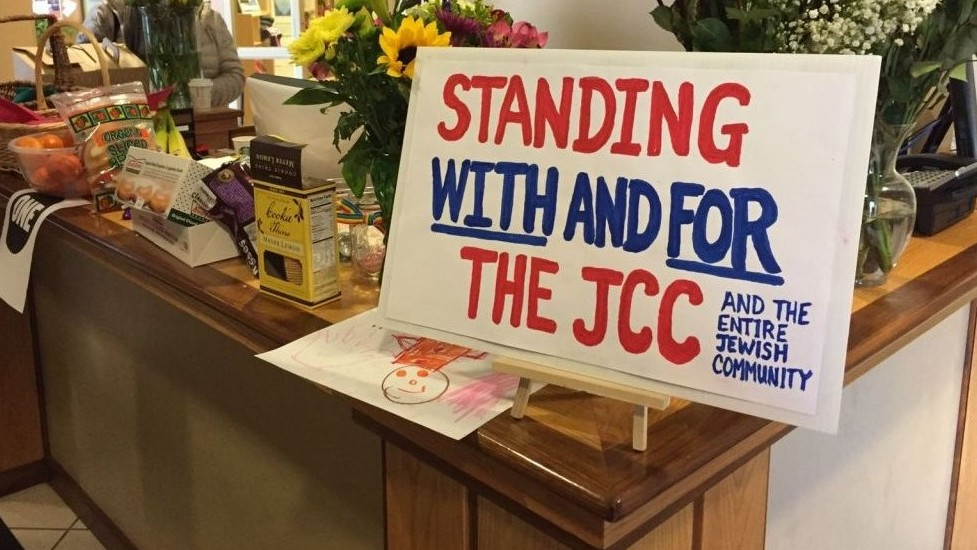 Signs, flowers and food delivered to the Asheville, North Carolina JCC by members of local churches on March 2, 2017, after the local community center received a bomb threat earlier in the week. (Courtesy/Tami Gross)