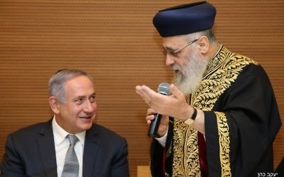 Prime Minister Benjamin Netanyahu, left, and Chief Sephardic Rabbi Yitzhak Yosef attend a ceremony marking 25 years to the 1992 terror attack on the Israeli embassy in Buenos Aires at the foreign ministry office in Jerusalem on March 6, 2017. (courtesy/Yaakov Cohen)