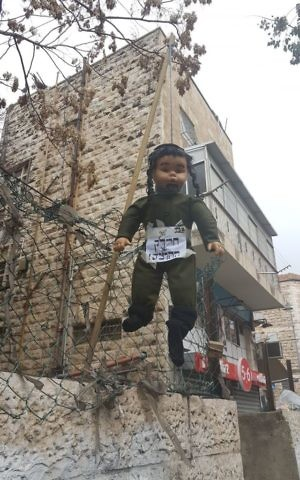 An effigy of a religious soldier in the ultra-Orthodox Jerusalem neighborhood of Mea Shearim on March 13, 2017. (Police Spokesperson)