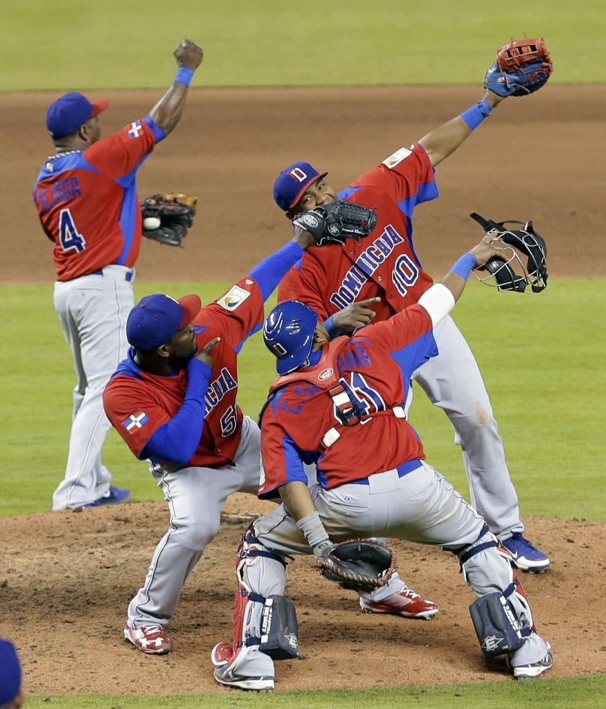 FILE - In this March 13, 2013, file photo, Dominican Republic players celebrate their 3-1 win over the United States in a second-round game of the World Baseball Classic in Miami. (Alan Diaz/AP)