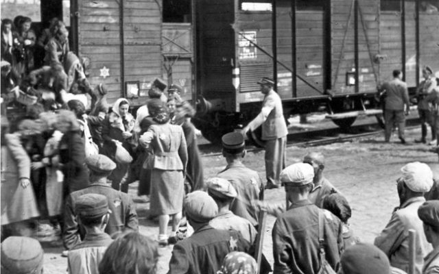 Beginning in 1942, Jews in the Lodz ghetto of Nazi-occupied Poland were deported to death camps including Chelmno and Auschwitz-Birkenau. (Yad Vashem)