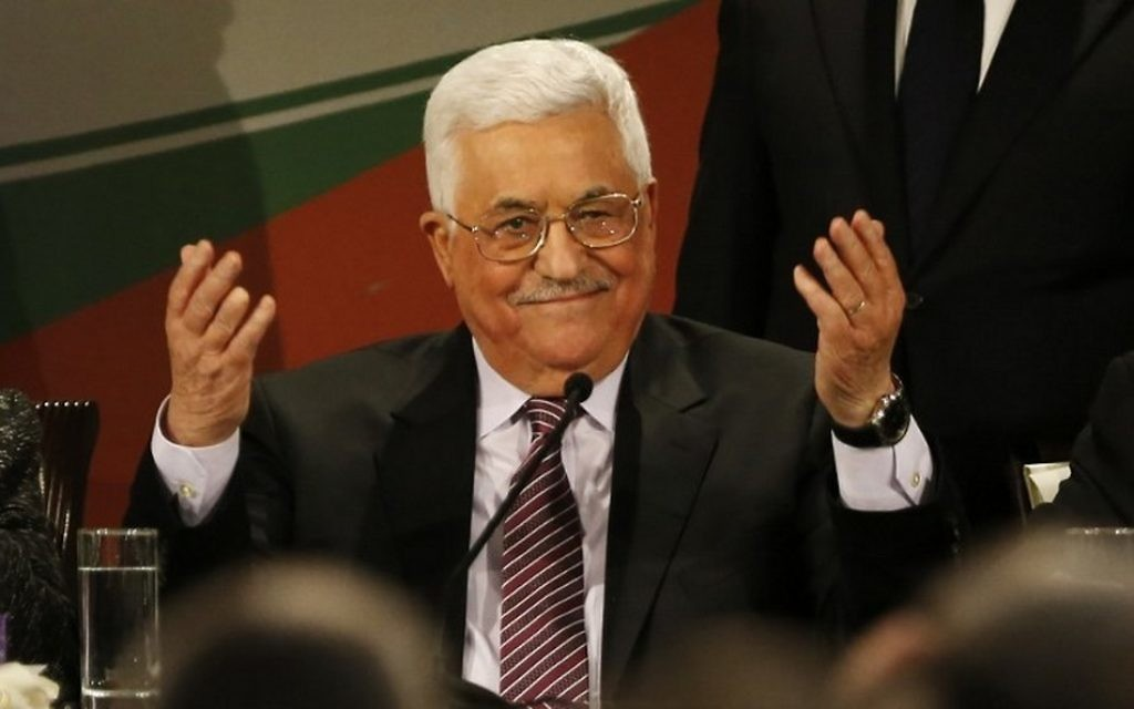 Palestinian Authority President Mahmoud Abbas gestures after delivering a speech on the second day of the 7th Fatah Congress in the West Bank city of Ramallah on November 30, 2016. (AFP/Abbas Momani)