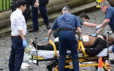 A man is treated by emergency services outside the British Parliament in London on Wednesday March 22, 2017. Reports claim this man to be responsible for the attack that killed three. (Screen capture/YouTube)
