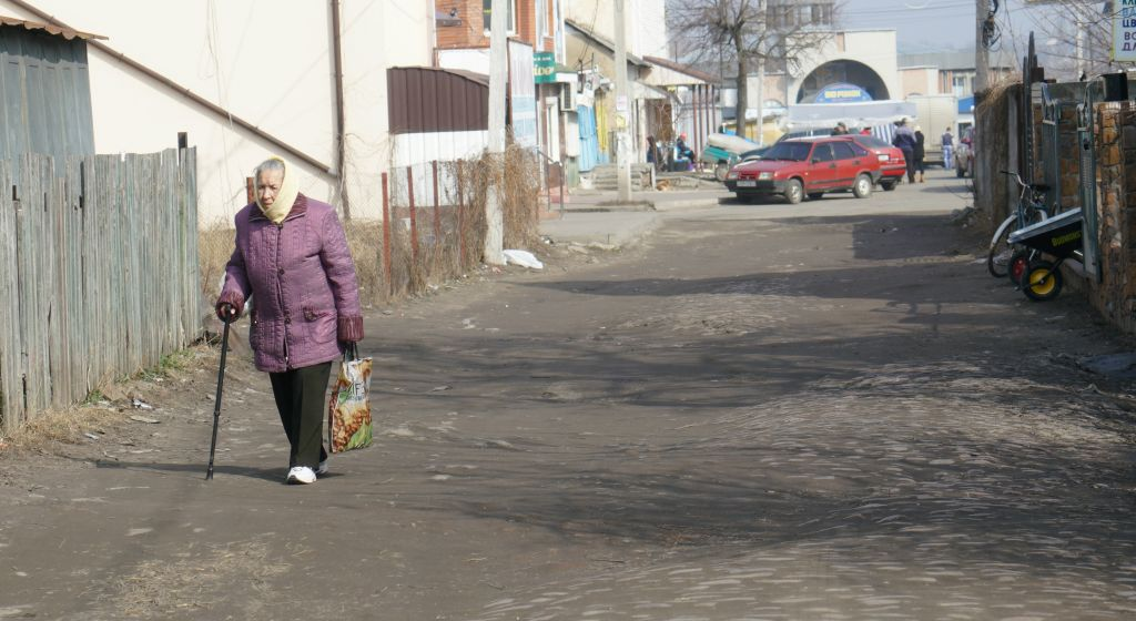 A resident of Bershad, Ukraine, entering the town's Jewish quarter, March 9, 2017. (Cnaan Liphshiz/ JTA)