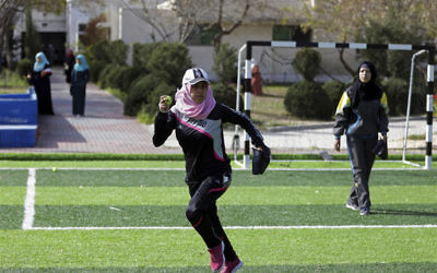 In this Sunday, March 19, 2017 photo, Palestinian women train for an all women's baseball game, on a soccer field, in Khan Younis, southern Gaza Strip. (AP Photo/Khalil Hamra)