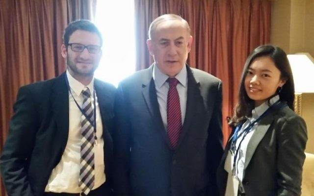 Prime Minister Benjamin Netanyahu in his Beijing hotel room, interviewed by The Times of Israel's diplomatic correspondent Raphael Ahren (left) and Times of Israel's Chinese editor Yifeng Zhou (Times of Israel staff)