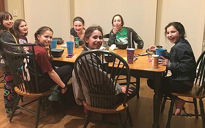 Sophie Golden, in striped shirt and headband, uses social media to coordinate meet-ups with her camp friends. (Davina Golden/via JTA)