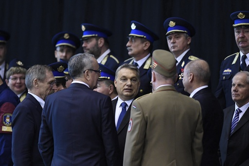 "Hungarian Prime Minister Viktor Orban, center, attends a swearing-in-ceremony for a new group of border guards known locally as ""border hunters,"" in Budapest, Hungary, Tuesday, March 7, 2017. (Szilard Koszticsak/MTI via AP)"