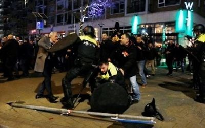Dutch riot police clash with protesters near the Turkish consulate in Rotterdam on March 11, 2017 after the Turkish Family Minister was barred by police from entering the Turkish consulate and escorted out of the country. (Marten van Dijl/AFP)