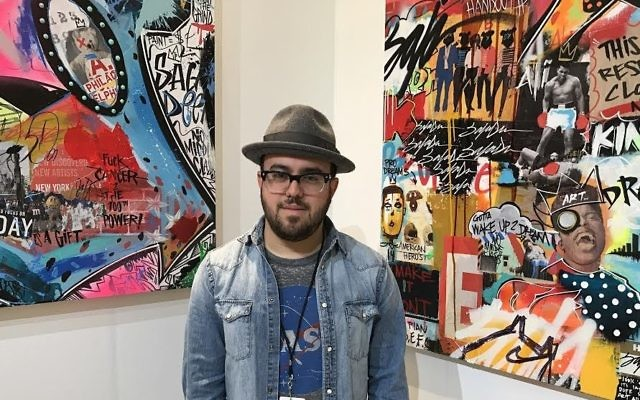 Erez Safar at Scope, a New York showcase for artists. (Madison Margolin/Times of Israel)