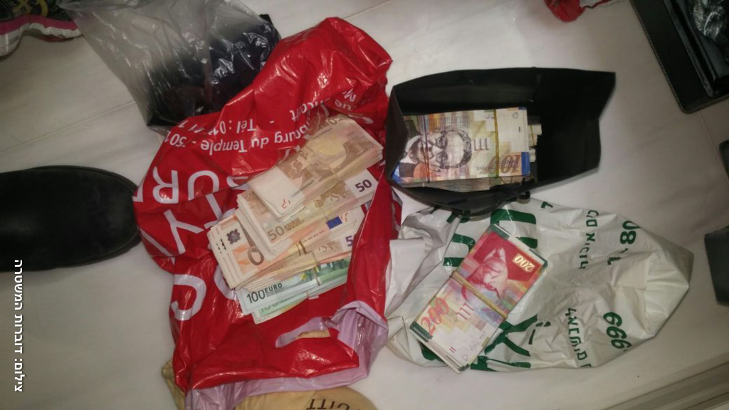 Some of the assets seized in a March 1, 2017 raid by Israeli police in conjunction with the FBI (Photo courtesy of Israel Police)
