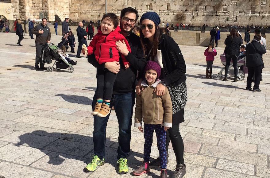 Gadi and Atara Yunger with their son Itai, 3, and daughter Neriyah, 6, at the Western Wall in Jerusalem. (Courtesy of Gadi Yunger/via JTA)