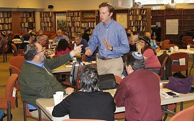 Rabbi Ethan Tucker, a co-founder of Hadar, speaking with rabbis during a seminar at the New York yeshiva, March 1, 2017. (JTA/Ben Sales)