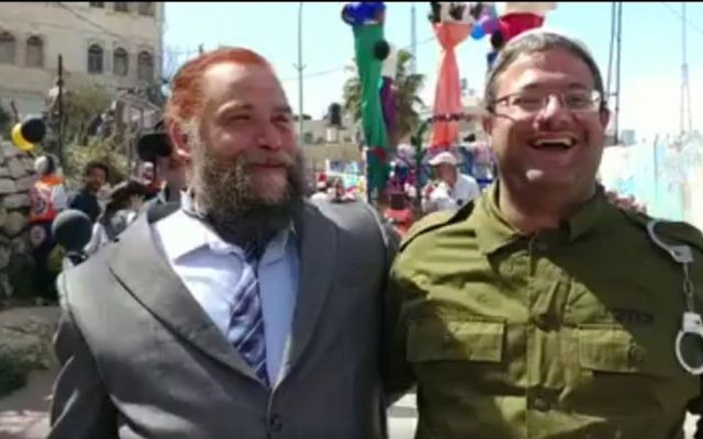 Attorney Itamar Ben Gvir (R) dressed up as IDF solider Elor Azaria, and Lehava leader Bentzi Gopstein dressed up as US President Donald Trump, attend a Purim celebration in the West Bank city of Hebron on March 12, 2017. (screen capture: Channel 10)