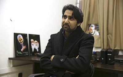 """In this Feb. 26, 2017 photo, Farhad Azima, the Iranian director and screenwriter of the animated film """"Battle of the Persian Gulf II,"""" gives an interview to The Associated Press, at his office, in Tehran, Iran. (AP Photo/Vahid Salemi)"""