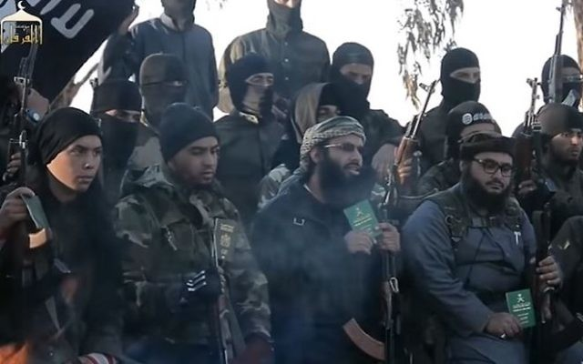 A screen capture from an Islamic State propaganda video, depicting soldiers calling on Muslims to surrender their foreign passports and join the terror group. (YouTube)