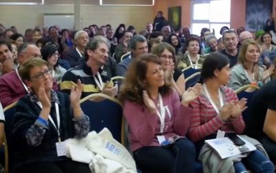 Audience members applaud during a Limmud FSU (former Soviet Union) session in footage from a video celebrating ten years of the conference's existence. (Screen capture/YouTube)