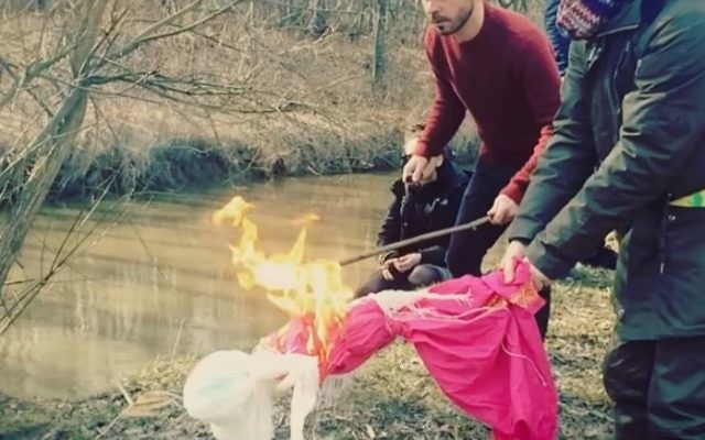 Illustrative image of Polish people celebrating the first day of spring by burning a Marzanna effigy and throwing it into the Vistula River. (screen capture: YouTube)
