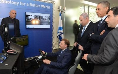 Ziv Aviram, President and CEO of Mobileye, demonstrates the driverless car to Israeli Prime Minister Benjamin Netanyahu (2R) and former US president Barack Obama (C) during an exhibition of technological innovation at the Israel Museum, as Amnon Shashua (R), Mobileye's co-founder and chief technology officer, looks on. Jerusalem, March 21, 2013. Photo by Kobi Gideon / GPO /FLASH90