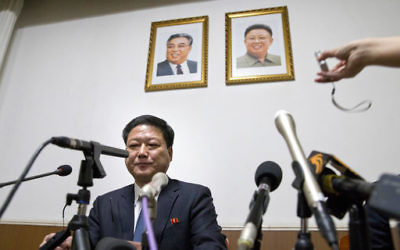 Pak Myong Ho, minister of the North Korean Embassy in China, sits under portraits of the late North Korean leaders Kim Il Sung, left, and Kim Jong Il during a press conference in Beijing, China, Thursday, March 16, 2017. (AP Photo/Ng Han Guan)