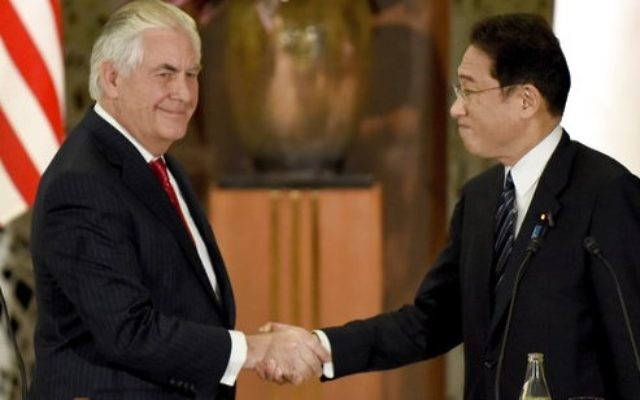 U.S. Secretary of State Rex Tillerson, left, shakes hands with his Japanese counterpart Fumio Kishida at the end of a joint press conference after their talks at the Iikura Guesthouse in Tokyo Thursday, March 16, 2017.  (Toru Yamanaka/Pool Photo via AP)