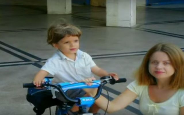 Olga Borisov with son Alon, whom she killed in 2008.  (YouTube screenshot, Channel 1 TV)