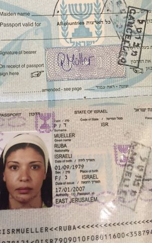 The Israeli passport of Jerusalem-born Palestinian Ruba Mueller, stamped as cancelled because she left Israel immediately after obtaining it 10 years ago, March 14, 2017. (AP Photo/Karin Laub)
