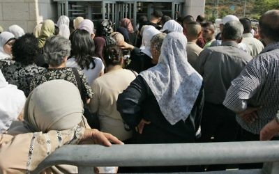 Palestinians queue in front of the Interior Ministry branch in East Jerusalem, July 6, 2008.  (AP Photo/Sebastian Scheiner, File)