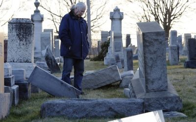 A man looks at fallen tombstones at the Jewish Mount Carmel Cemetery, February 26, 2017, in Philadelphia, PA. (AFP/Dominick Reuter/Getty Images)