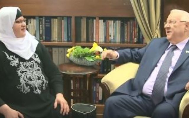 Taibe Hebrew teacher Jehan Jaber (L) meets with President Reuben Rivlin in his Jerusalem residence on March 8, 2017. (Screen capture/Facebook)