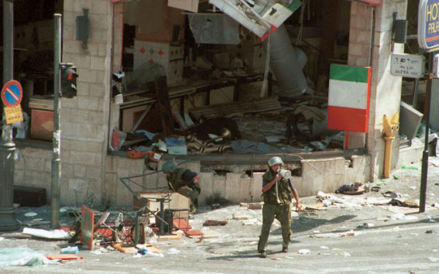 Israeli soldiers checking for explosives at Sbarro pizzeria in Jerusalem after a Palestinian suicide bombing that killed 15 people, August 9, 2001. (Courtney Kealy/Getty Images/JTA)