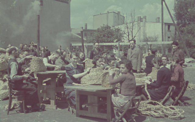 Jewish inmates of the Lodz ghetto in Nazi-occupied Poland at labor making baskets (United States Holocaust Memorial Museum)