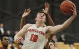 Spencer Weisz #10 of the Princeton Tigers attempts to go up and under against the Saint Joseph's Hawks during the second half at the L. Stockwell Jadwin Gymnasium on December 14, 2016 in Princeton, New Jersey. Saint Joseph's won 76-68. (Corey Perrine/Getty Images)
