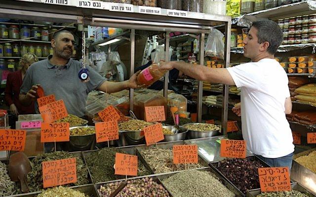 Chef Michael Solomonov samples spices at the Levinsky Market in Tel Aviv. (Florentine Films)