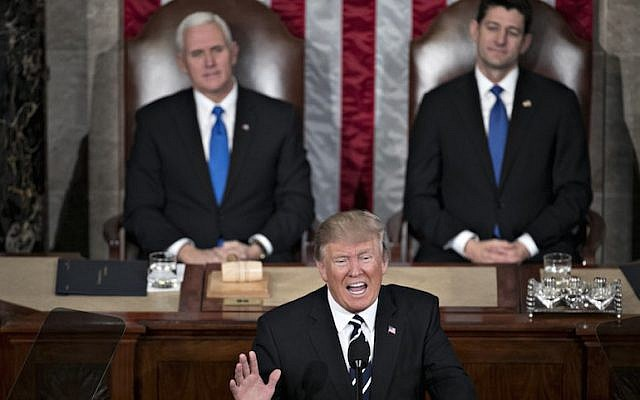 US President Donald Trump, center, speaks as US Vice President Mike Pence, left, and US House Speaker Paul Ryan, a Republican from Wisconsin, listen during a joint session of Congress in Washington, D.C., US, on Tuesday, Feb. 28, 2017. (Andrew Harrer/Bloomberg)