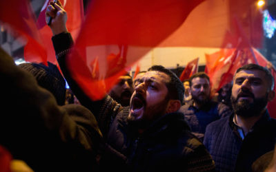 Protesters sing songs and chant slogans outside the Dutch Consulate on March 12, 2017 in Istanbul, Turkey. (Chris McGrath/Getty Images)