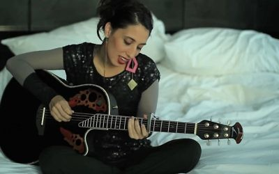 Yael Meyer playing guitar in her music video 'Everything Will Be Alright.' (YouTube)