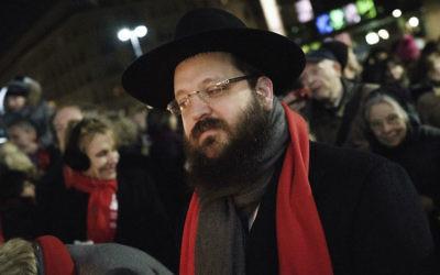 Rabbi Yehuda Teichtal at a Hanukkah ceremony at the Brandenburg Gate in Berlin, December 6, 2015. (Carsten Koall/Getty Images/via JTA)
