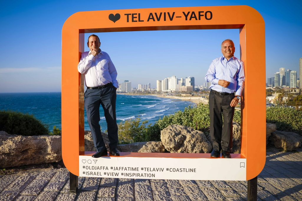Tel Aviv mayor Ron Huldai and Jaffa historic site director Yaron Klein in the oversized picture frame recently erected on the Jaffa coastline (Courtesy Guy Yehieli)