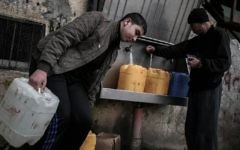 Palestinians fill bottles and jerrycans with drinking water from public taps at the Rafah refugee camp in southern Gaza Strip, on February 22, 2017. (Said Khatib/AFP)
