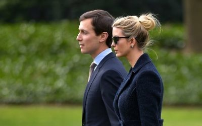 This file photo taken on March 3, 2017 shows Senior Advisor to the President, Jared Kushner (L), walking with his wife Ivanka Trump to board Marine One at the White House in Washington, DC.  (AFP/Mandel Ngan)