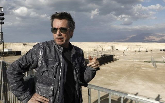 French electronic music pioneer Jean-Michel Jarre speaks during an interview as he prepares for his upcoming concert to publicise the plight of the shrinking Dead Sea at the ancient clifftop fortress of Massada, on April 2, 2017. (Menahem Kahana/AFP)