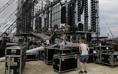 Workers prepare the stage for French electronic music pioneer Jean-Michel Jarre ahead of his upcoming concert to publicize the plight of the shrinking Dead Sea at the ancient clifftop fortress of Masada, on April 2, 2017. (Menahem Kahana/AFP)